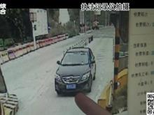 """遮挡号牌遇交警 女司机辩称""""风吹的"""""""