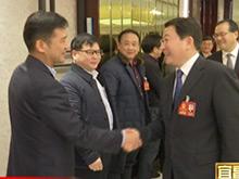 周霁马旭明看望出席市六届人大一次会议人大代表